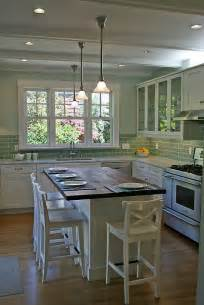 kitchen island with cabinets and seating communal setups top list of new kitchen trends cabinets