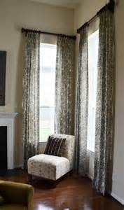 two story drapes with decorative wood poles contemporary