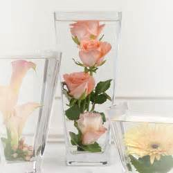 centerpieces that give quot putting flowers in water quot a new meaning budget friendly beauty