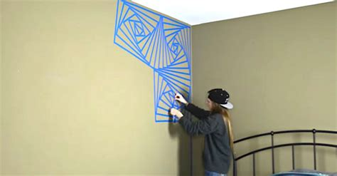 wall paint design ideas with tape she starts covering one corner of her room in blue tape