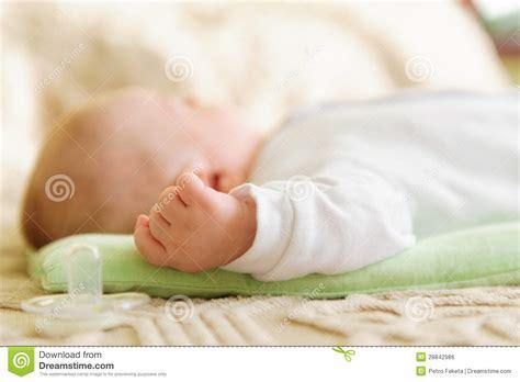 baby sleeping in bed cute newborn baby sleeping in bed royalty free stock image image 28842986