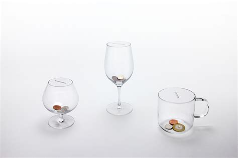 designboom wine studio yumakano tips glasses in their drink coin collection
