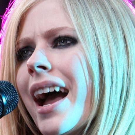 Avril Justifies Spitting On Photographers by Frightening Fangs Photo 6 Tmz