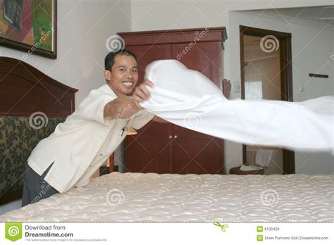 bed making by the staff picture of hotel goldi sands housekeeping or room boy staff stock image image 6130429