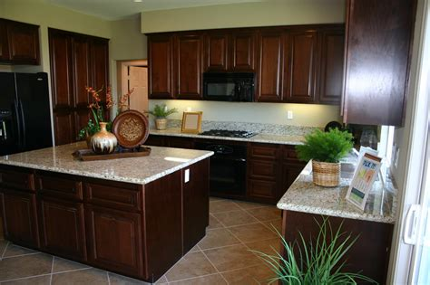 White Marble Countertops On Varnished Mahogany Kitchen