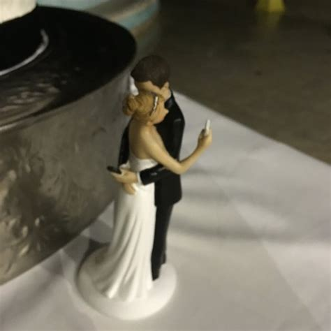 wedding cakes toppers wedding cake topper featuring a and groom checking