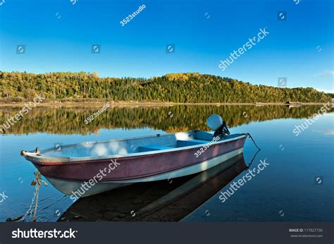 small boat in the ocean autumn forest reflection ocean small boat stock photo