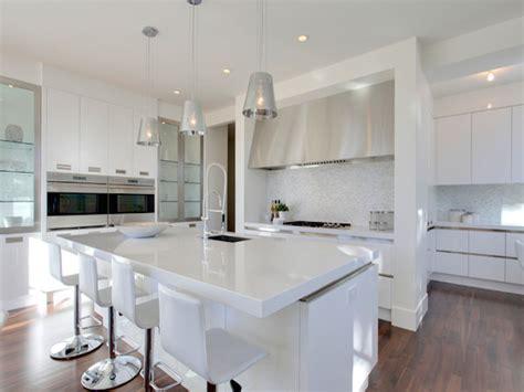 white kitchen cabinets white quartz countertops