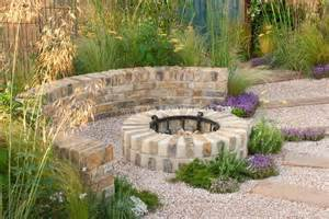 garden firepit fireplace of brick with pebble patio in