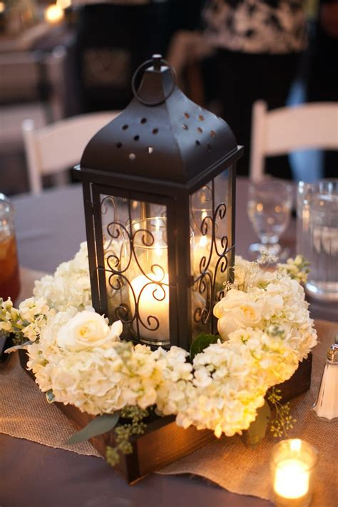 lantern centerpieces black lantern and white hydrangea centerpiece