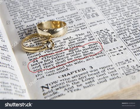 Bible Verses On Wedding Rings by Wedding Rings Place On Open Bible Stock Photo 45290542