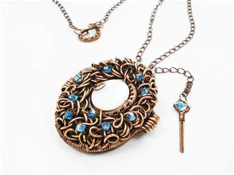 Handmade Metal Jewelry - handmade wire wrapped copper locket photo locket moodart