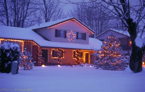christmas houses in snow snowy house with lights photo wp02926