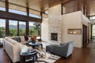 This living room with it s high ceiliigs and floor to ceiling windows
