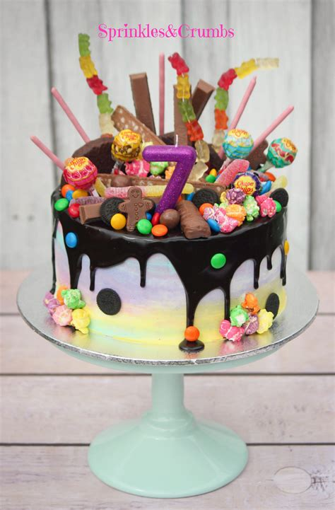 rainbow candy drip cake pale frosting paired  crazy toppings awesome combo  yo