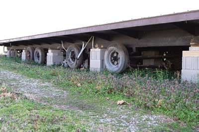 used mobile home trailer frames for the track hoe lifting the frame parallel to creek bed