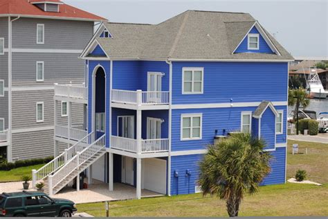 blue beach houses bright blue beach house traditional other by land to