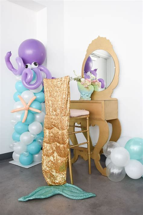 105 balloon column with octupus sea creature gold vanity with gold chiavari chair stool