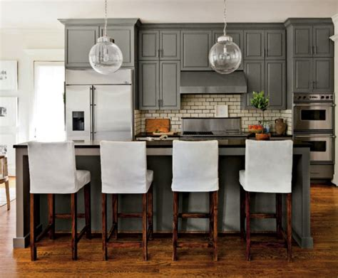 grey kitchen cabinets with black countertops subway tiles transitional kitchen