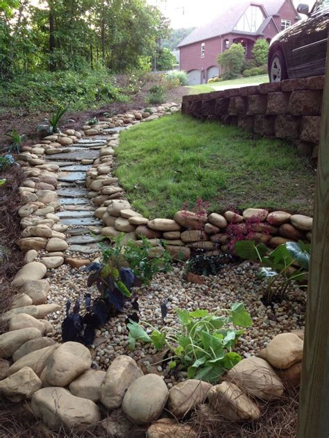 the creek bed that ends into a garden i designed