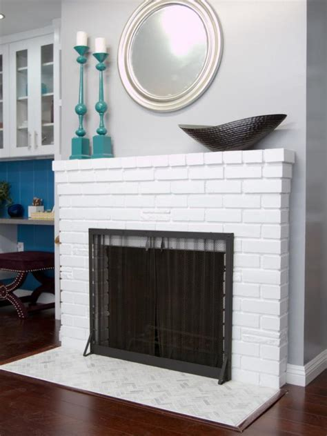 white painted brick fireplace  herringbone tile hearth