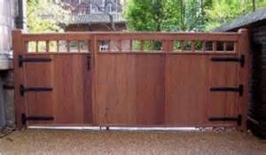 Attached Carport Designs wide wooden driveway gate and attached pedestrian gate