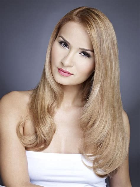 sleek long hair with a face framing curve and a tapered angle