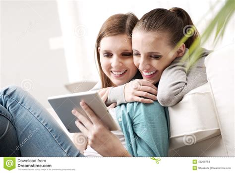 lesbians having on the couch happy lesbian couple with tablet stock photo image 46298784