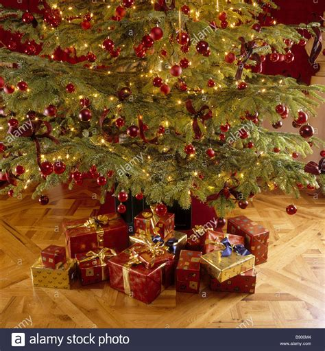 old fashioned christmas tree with decorations and presents