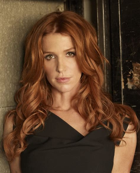 actress with red hair in tv show unforgettable poppy montgomery dylan walsh daya vaidya