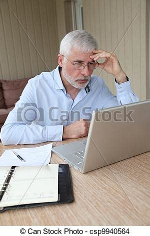 stock photo of senior businessman working at home