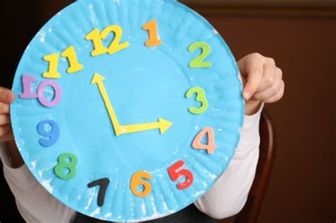 How To Make Clock Using Paper Plate - paper plate clock craft happy hooligans