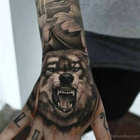 wolf hand tattoo wolf tattoos designs pictures page 2