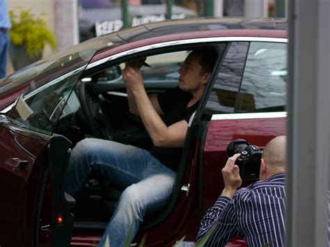 tesla person koch brothers go to war against electric cars elon musk sighs