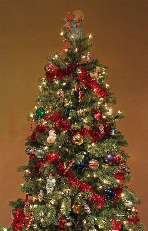 decorating a christmas tree to look old fashioned an fashioned tree photograph by suzanne gaff