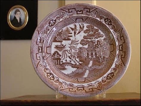 brown willow pattern plates brown and white transferware plate content in a