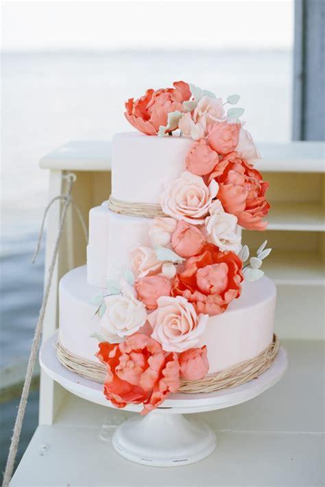 romantic  tier wedding cake  peach coral blooms