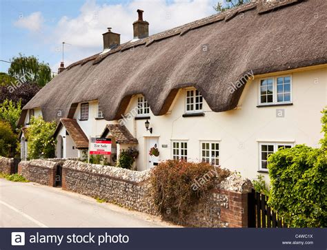 english cottages for sale thatched cottage uk old english semi detached terrace in a little stock photo royalty free