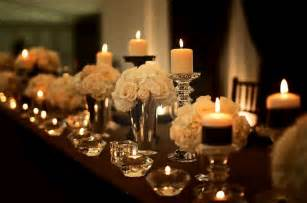 Elegant wedding reception tablescape with white flowers and lots of