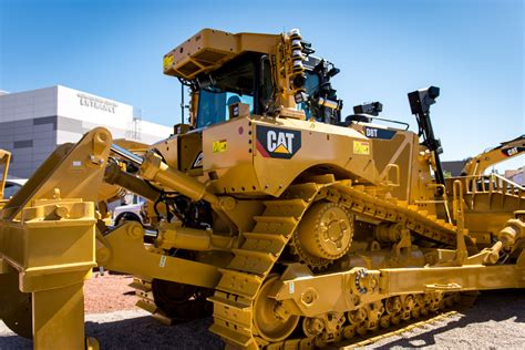 Cat Consruction operating a d8t 1 700 away with cat s remote operator system at conexpo