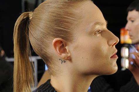 sagittarius tattoo behind ear ear tattoologist