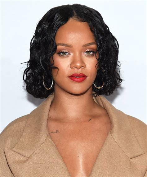 Rihanna Curly Hairstyles by Rihanna S Shiny Curly Bob Instyle