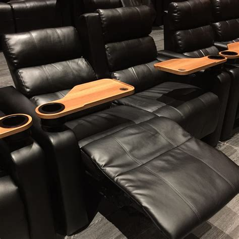 regal cinemas reclining seats comfortable reclining seats with a extendable food table