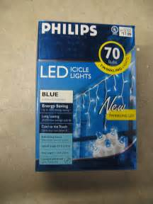 twinkling led icicle christmas lights by philips a photo