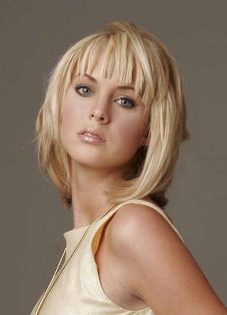 hairstyles medium length with wispy fringe and slightly curly layered medium haircuts with bangs