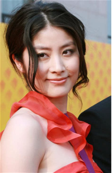 Kelly Chen Hot Picture With Elegant Updo With Curly Side Bangs.PNG