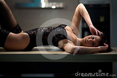 Girl In Lingerie Lying On The Kitchen Table Royalty Free