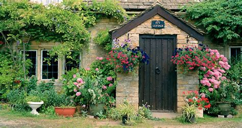european photo of cottage with flowers in lower