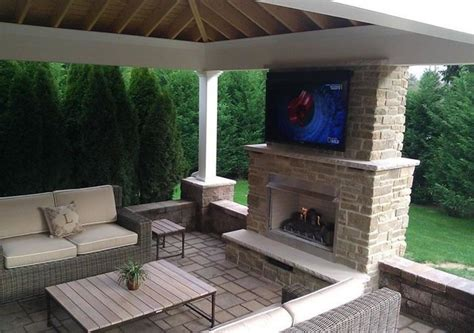 outdoor fireplace and living room installation modern