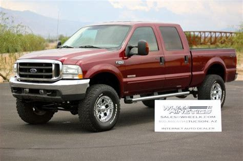 buy used 2004 ford f250 diesel lariat 4x4 crew cab 4wd leather lifted 61k miles see video in